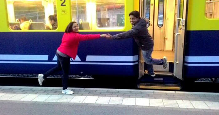 Payal posing in front of a train on her Europe trip