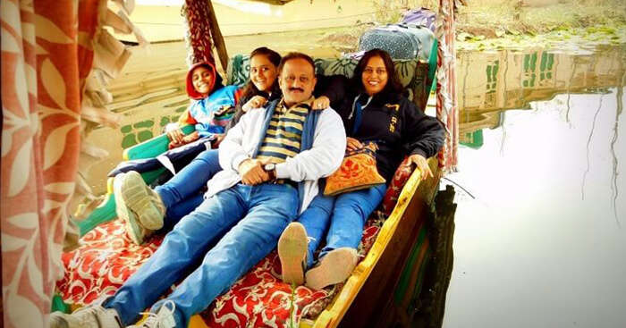 A family takes a shikara ride in Kashmir