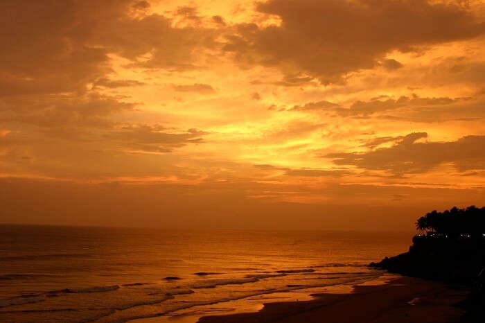 A beautiful view of the setting sun at Varkala Beach