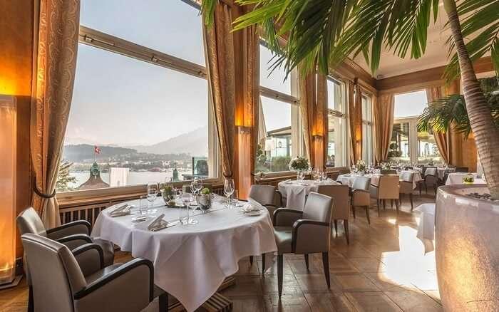 The dining area of the Art Deco Hotel Montana Luzern guarantee a perfect Switzerland honeymoon