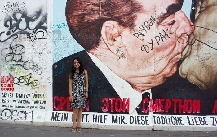 Leena in the background of the Berlin Wall