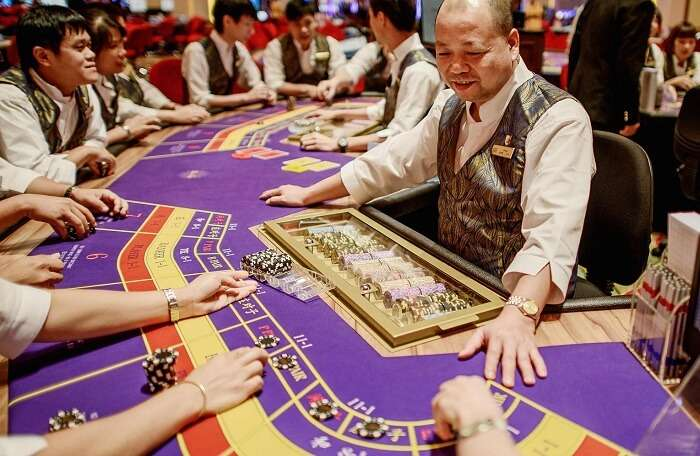 Happy hosts and guests at a casino in Macau