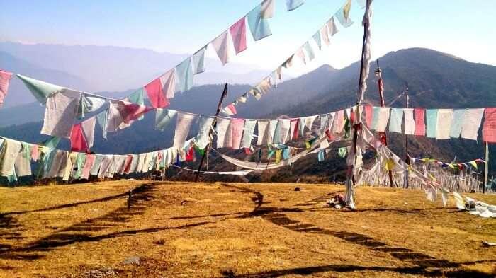 Colourful flags flying across a Bhutan hilltop