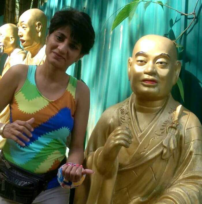 Enjoying a moment with the golden monk in Hong Kong