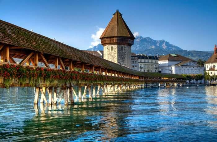 The wooden Chapel Bridge is perfect for a romantic walk while honeymooning in Switzerland