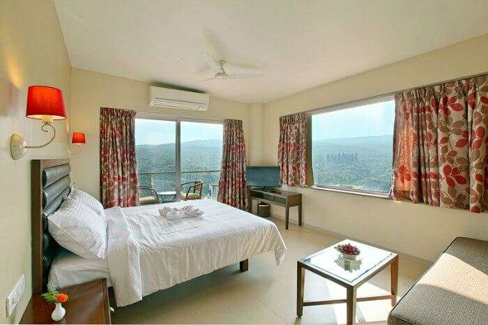 The stunning views of the rolling hills from a room at Bella Vista Resort, Mahabaleshwar