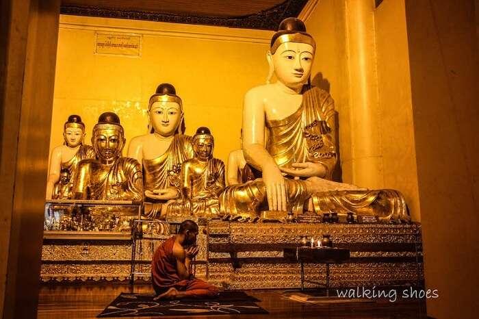 Monk praying in Myanmar
