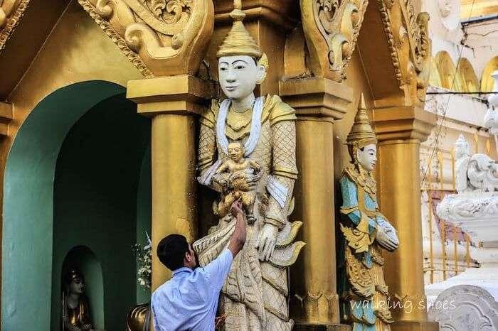 An artist making a sculpture in Myanmar