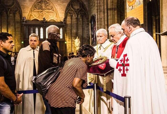 People praying inside a church in Paris