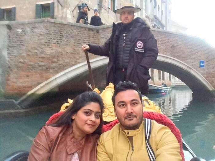 couple enjoying gondola ride in Venice