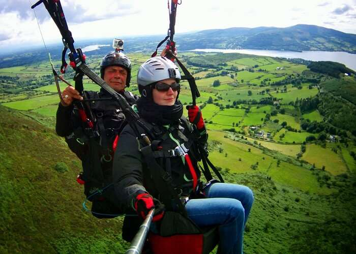 A flyer tries to click a selfie while paragliding in Bir Billing
