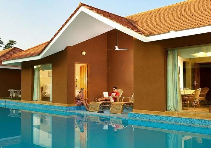 A couple relaxing at SAJ Earth Resort which is among the best resorts in Cochin