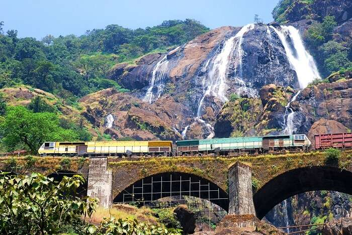 The train passing past Dudhsagar waterfalls in Goa