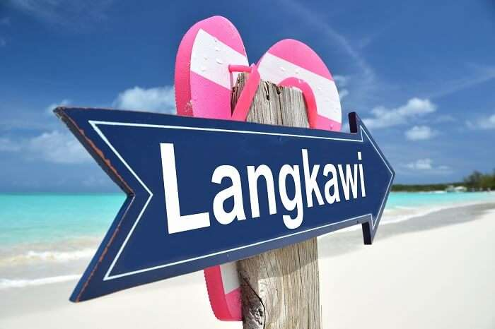 A signboard that reads Langkawi on one of the tropical beaches of the archipelago