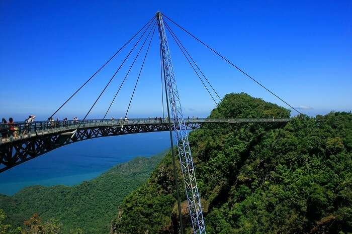 Tourists take a walk on the Langkawi Sky Bridge that overlooks the islets of Langkawi