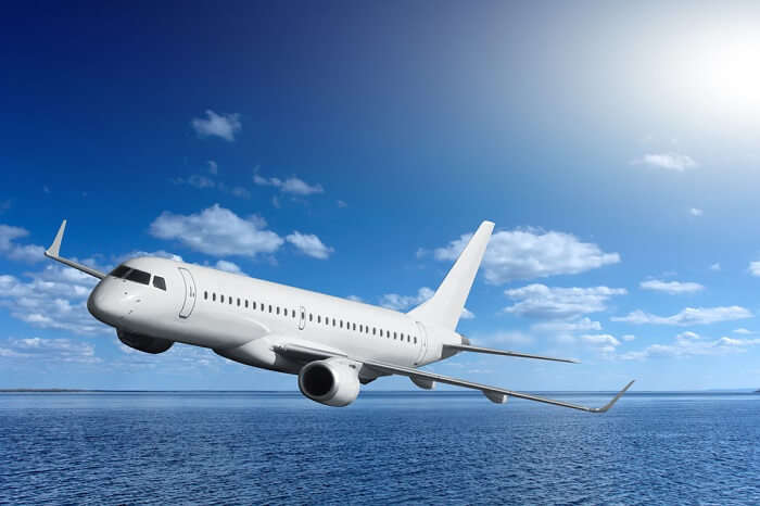 Airplane flying over sea to take eager passengers to Lakshadweep Islands