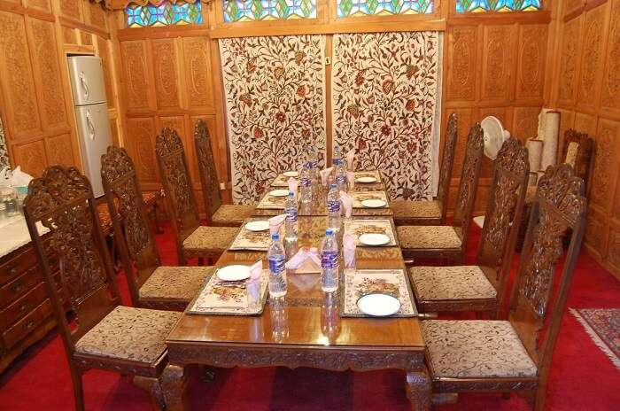 Dining areas inside the boat are as elaborately beautiful as any other part of the houseboat