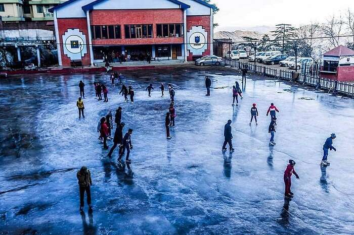 Tourists and locals try ice skating - one of the popular things to do in Shimla in winters