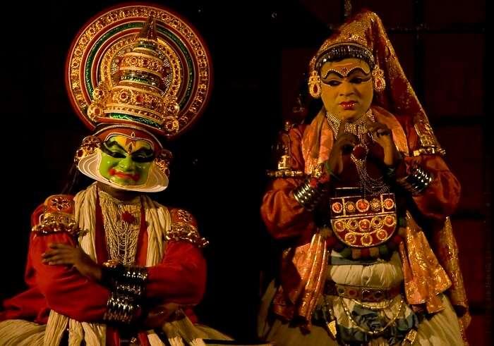 Kathakali performers on a stage in Kumarakom