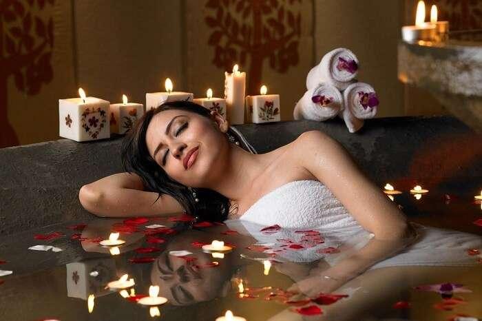 A woman enjoys an Ayurvedic treatment at the Maya Spa in Zuri Hotel