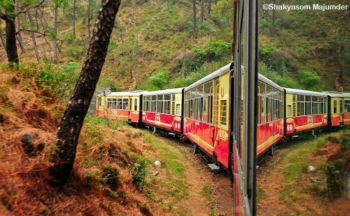 Reflection of the toy train between Shimla and Kalka on the window glass