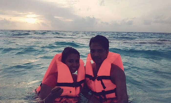 Badri and his wife swimming in Maldives
