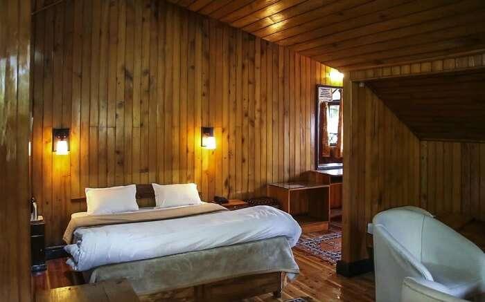 Wooden interiors of rooms in Gymkhana Resort