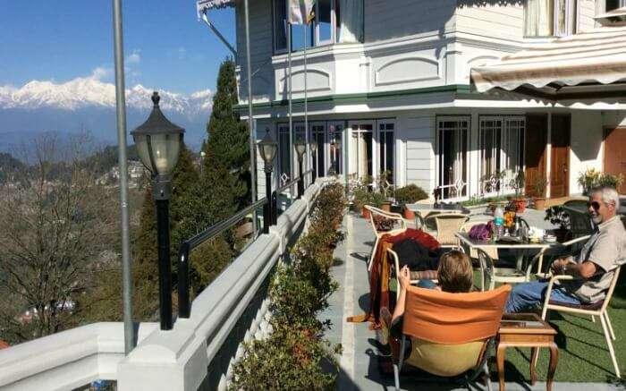 Guests relaxing and enjoying the Kanchenjunga Range view