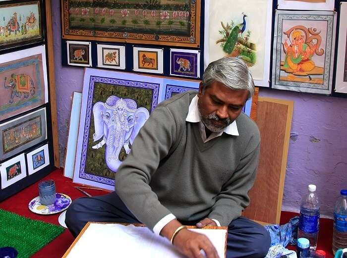 An artist sealing his thoughts on canvas at Hathi Pol Bazaar - One of the top shopping places in Udaipur