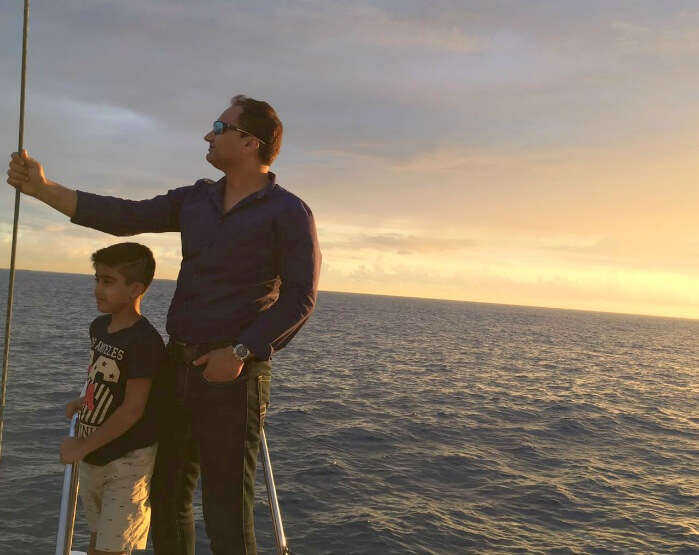 Raj Kumar and his son on the boat for submarine ride