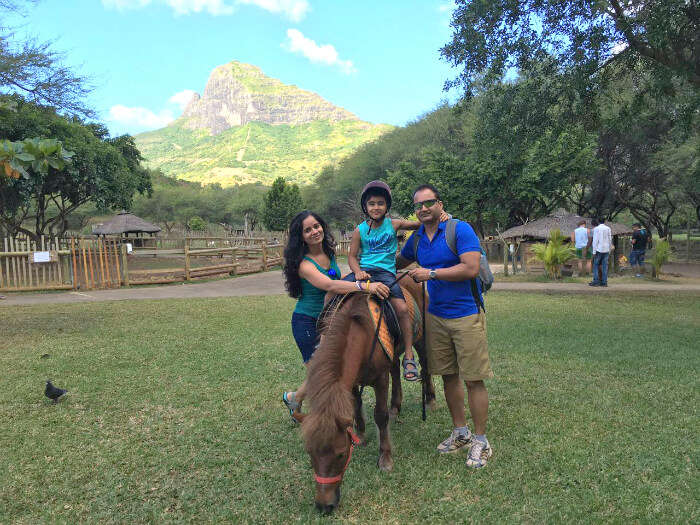 Raj Kumar and his family petting animals at Casela Nature Park