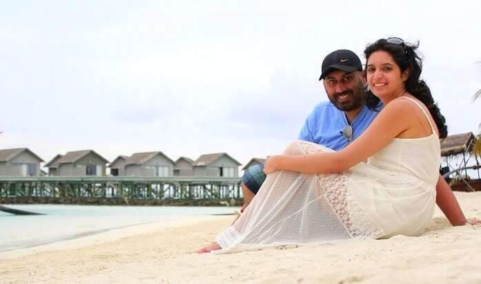 Angad and his wife on a beach in Maldives