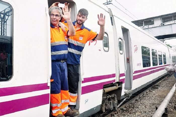 Pilots of Spanish train Talgo wave on their arrival at Moradabad Railway Station during the first trial run of the train between Bareilly and Moradabd