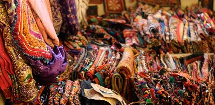 Textiles at display at Sadhna Emporium - one of the best shopping places in Udaipur