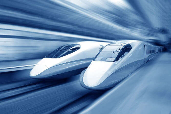 Two modern bullet trains speeding with motion blur
