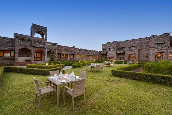The luxuriant garden and the stonework of the Bijolai Palace hotel in Jodhpur