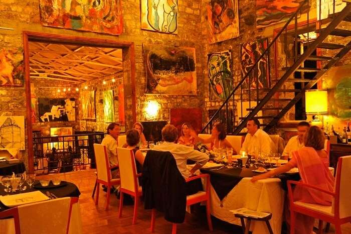 Tourists dining at the Cafe des Arts in Mauritius