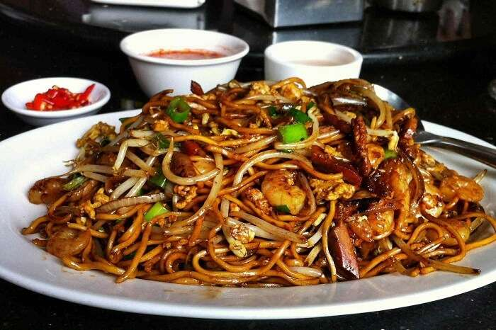 The popular Chinese Mine Frite dish being served with chutneys in Mauritius