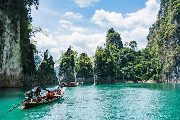 A group of travelers take a boat trip of the islands in Thailand