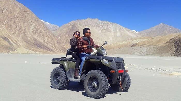 Vishal and his wife on a quad bike in Ladakh