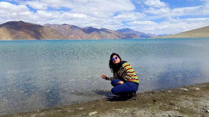 Vishals wife at the Pangong lake in Ladakh