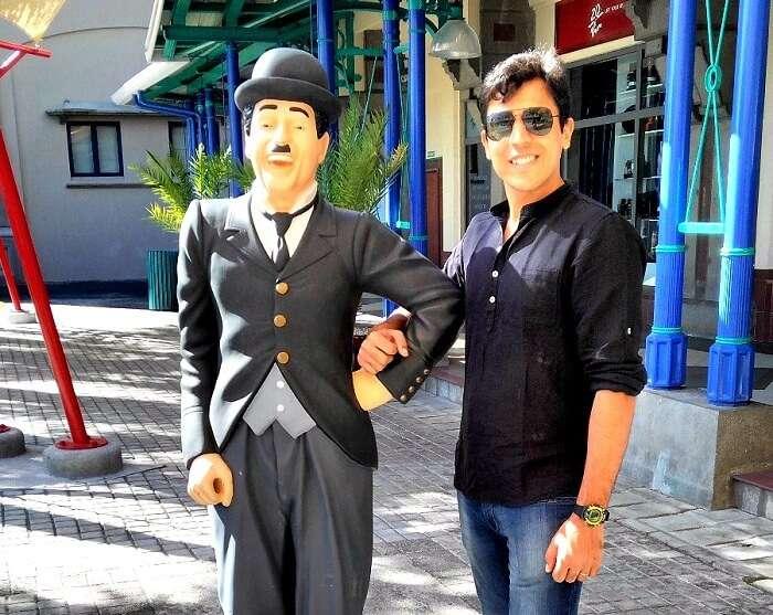 Sumit with Charlie Chaplin statue