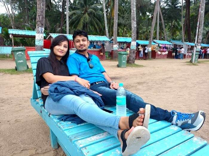 Vivek and his wife on a beach