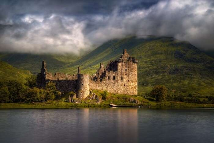 Reflections of the Kilchurn Castle in morning light in Scotland