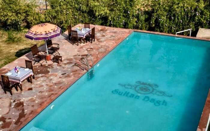 Pool side table at Sultan Bagh Resort