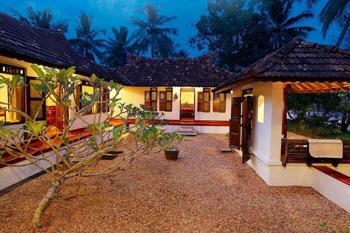 Well-lit villas of Philipkutty Farm in Kumarakom region in Kerala