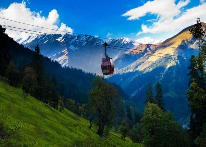 Enjoy the stunning snow capped vistas of Manali on a Gondola Ride