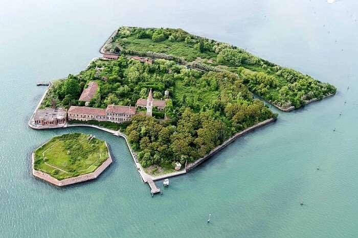 Bird eye view of the abandoned Poveglia Island in Italy