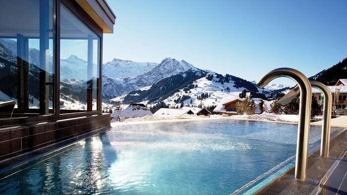 Pool in the background of icy mountains in The Cambrian, Adelboden, Switzerland