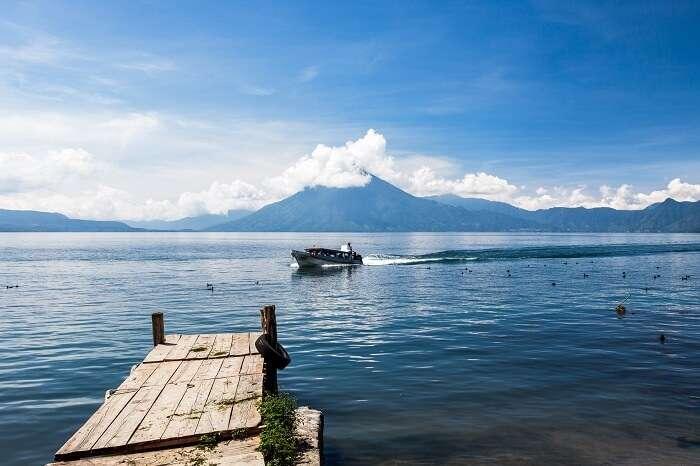 Beautiful view of Lake Atitlan in Panajachel with a boat entering the dock